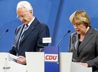 Edmund Stoiber y Angela Merkel, un día después de perder las elecciones de 2002.