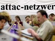 Miembros de Attac en una conferencia